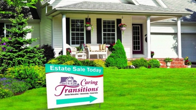 House with estate sales sign in front