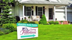 House with estates sales sign in front