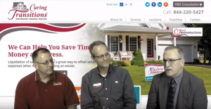 Caring Transitions Owners In Front of their Website