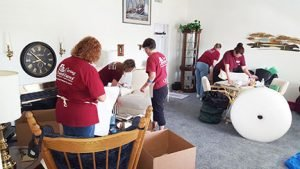 Caring Transitions Workers Packing Up a House