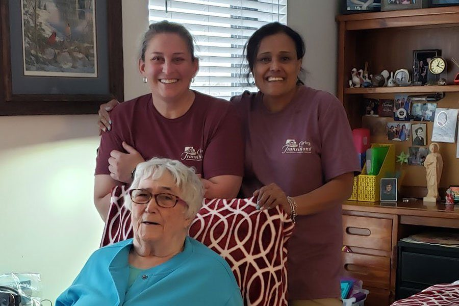 Caring Transitions Franchise Owners with a senior